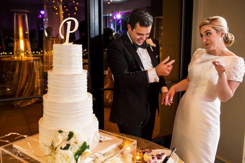 Sanctuary wedding cake cut Katrina and Andrew Photography