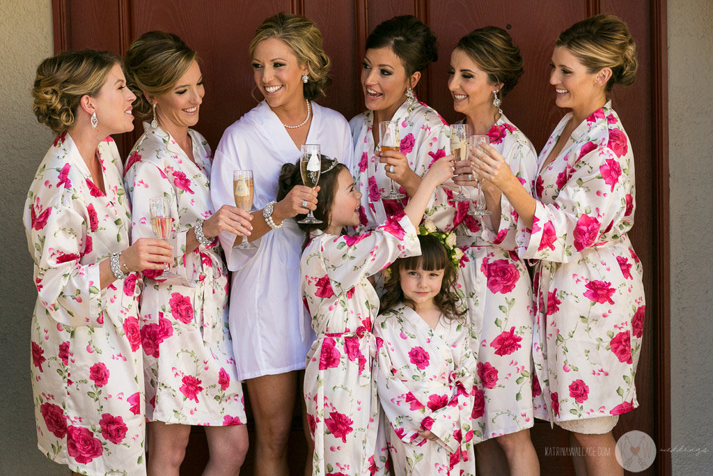 The bridesmaids share some laughs during a quick formal group shot