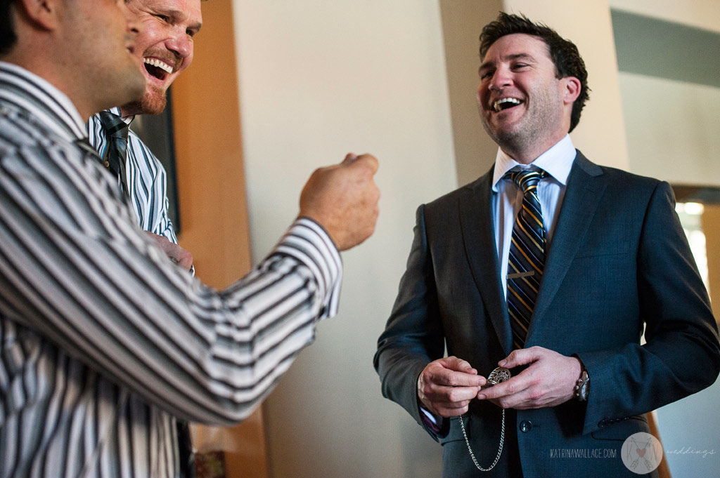 Alex shares a few laughs with his groomsmen before heading over to Brophey Chapel for the wedding ceremony