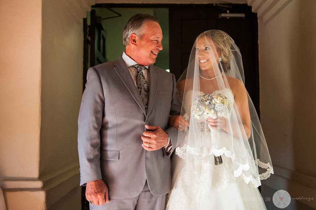 There is almost nothing as sweet as seeing a father and daughter exchange glances before he walks her down the aisle.