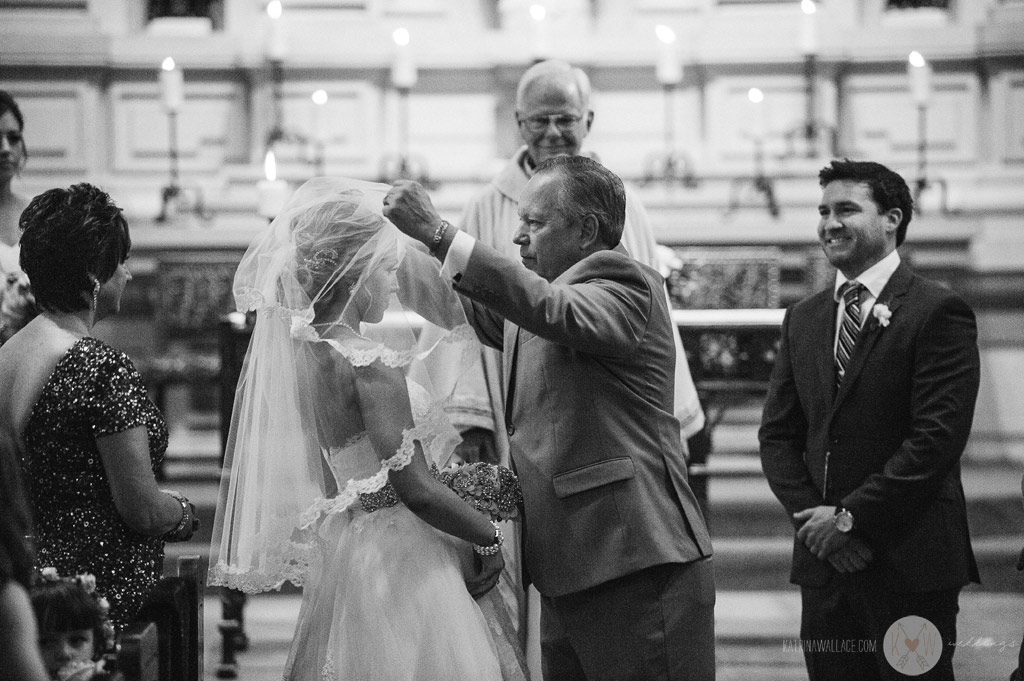 The father unveils the bride during the start of the Brophey Chapel ceremony