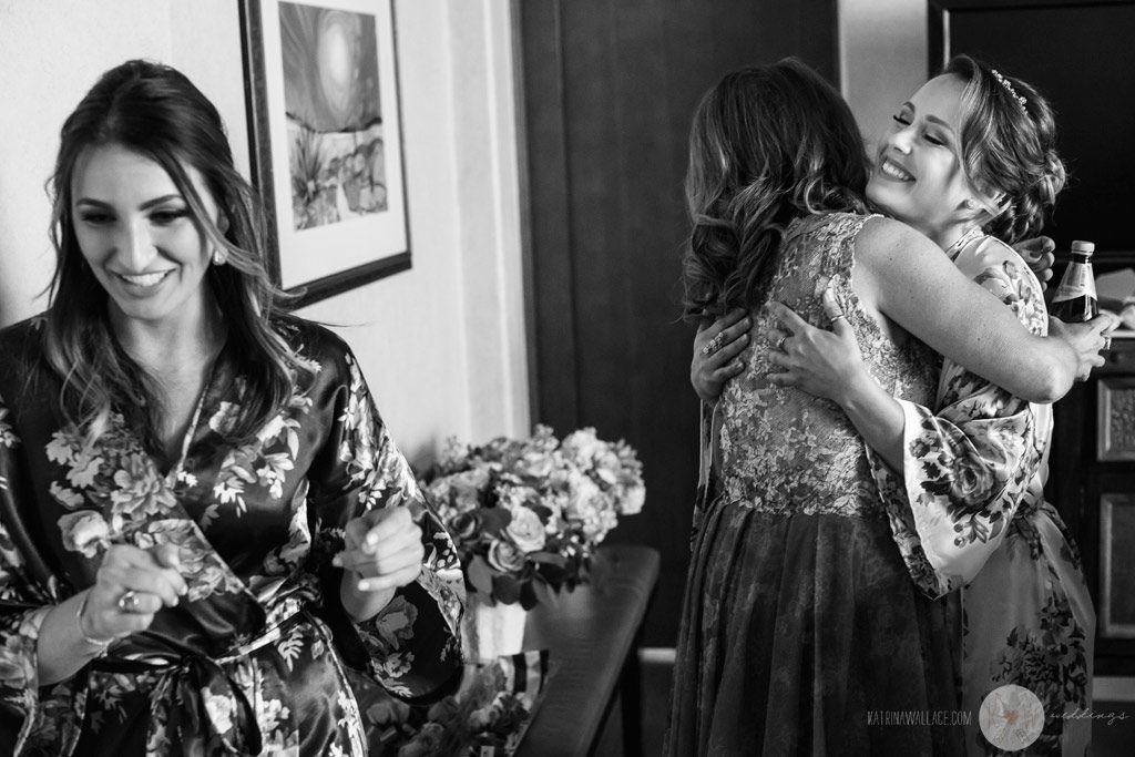 The bridesmaids hug with excitement about the wedding day at Four Seasons Scottsdale