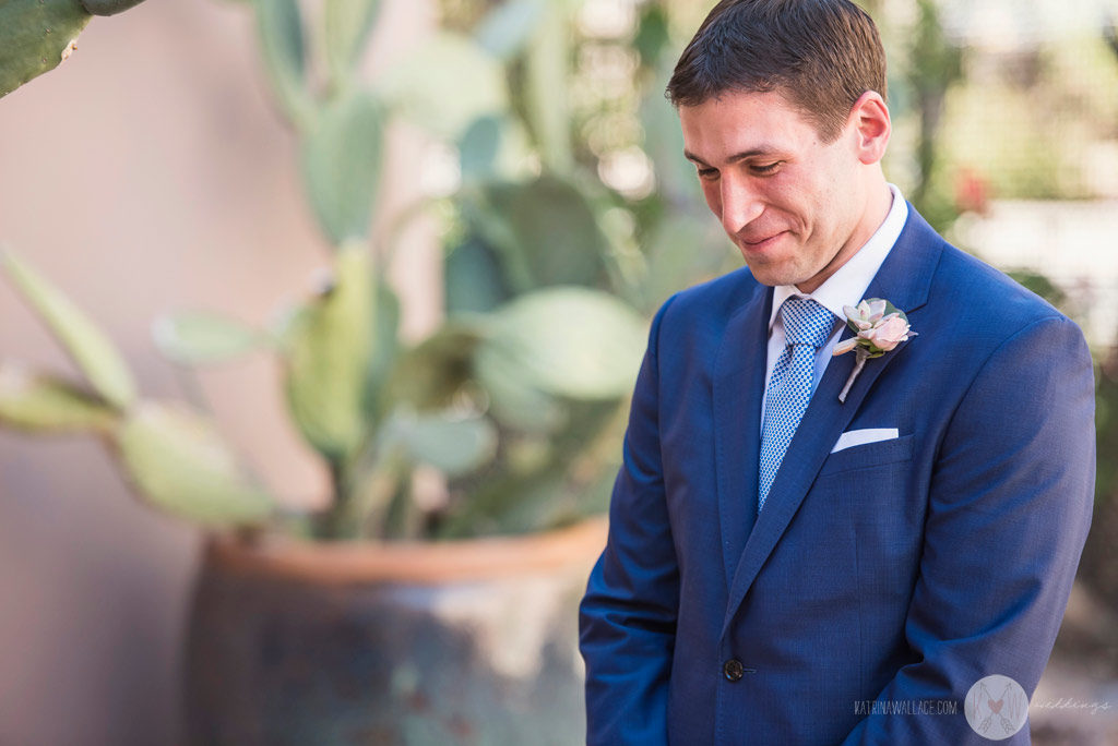 The handsome groom waits nervously for the bride just before they meet for the first time that day at the Four Seasons Scottsdale