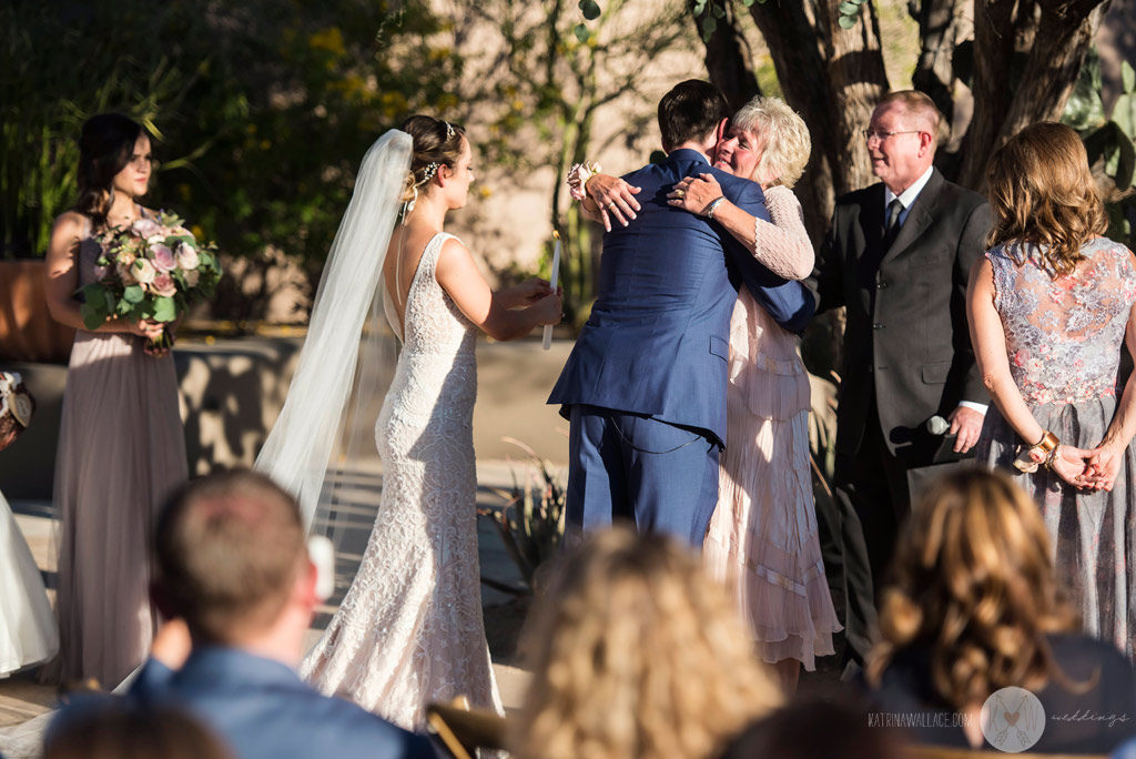 The Mothers exchange a hug after a quick candle-lighting ceremony at the Four Seasons Scottsdale wedding.